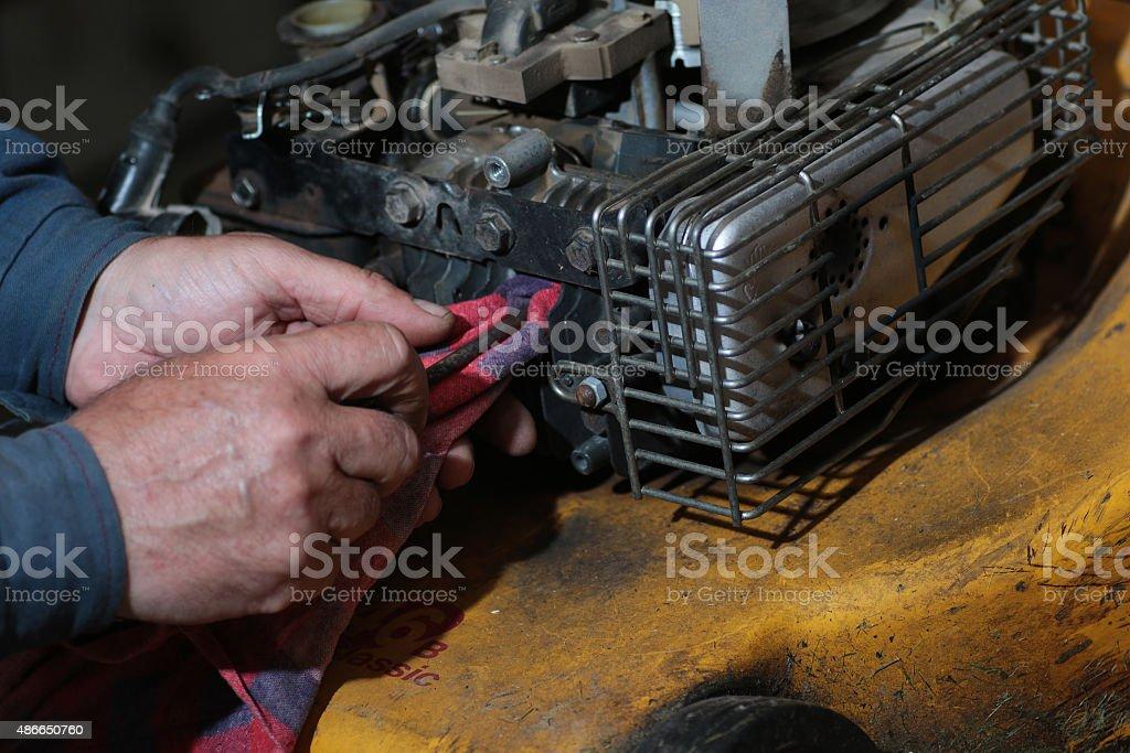 repairing lawn mower engine stock photo