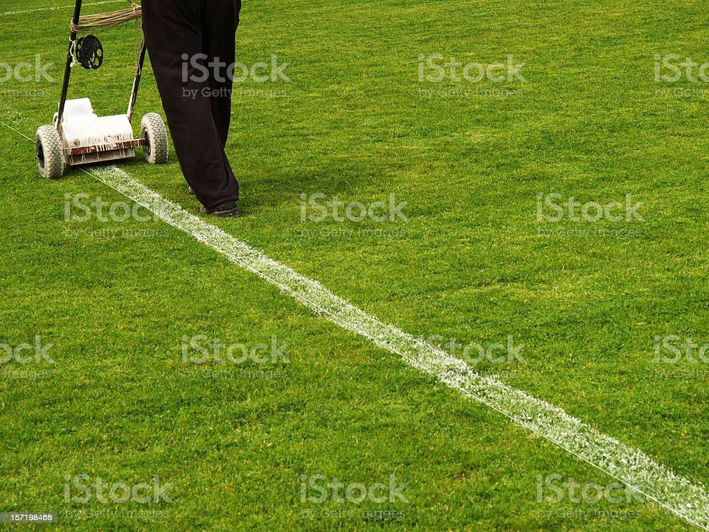 Repairing Line on Football Field royalty-free stock photo