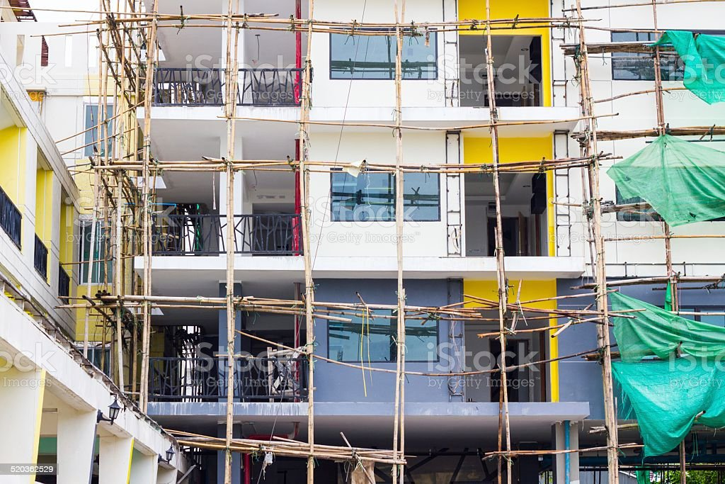 repairing old building and bamboo scaffolding stock photo