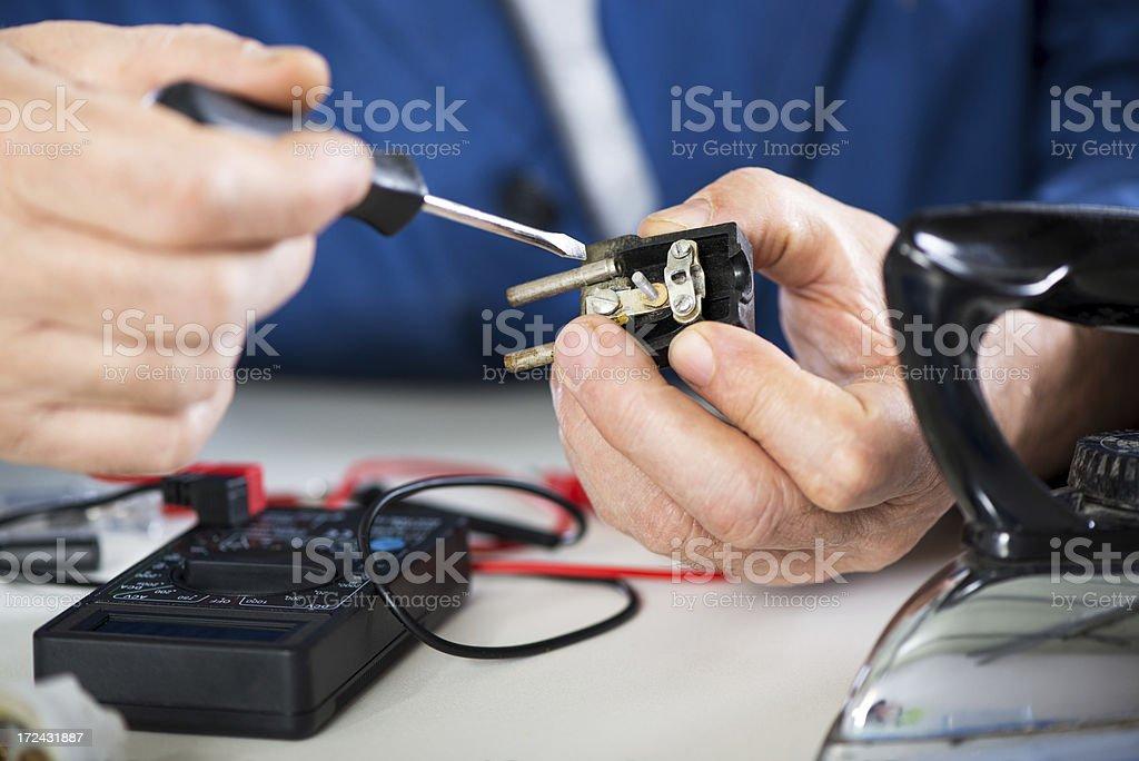 Repairing Old Power Plug royalty-free stock photo