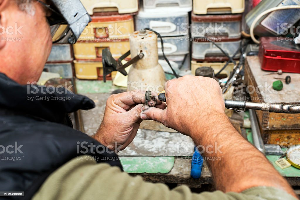 Repairing Ring stock photo