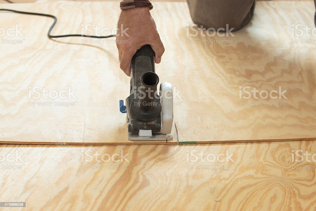 Repairing subfloor, with new plywood, DIY stock photo