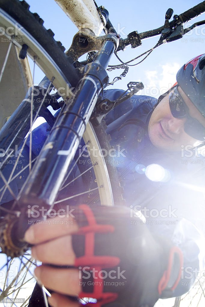 repairing the bicycle royalty-free stock photo