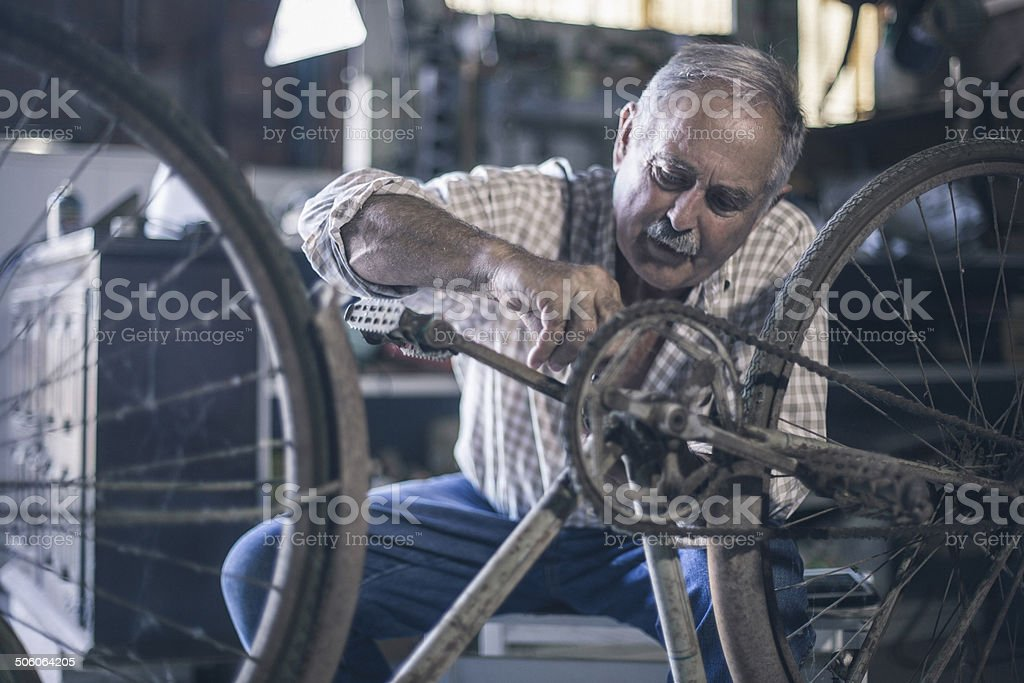 Repairing the bycicle royalty-free stock photo