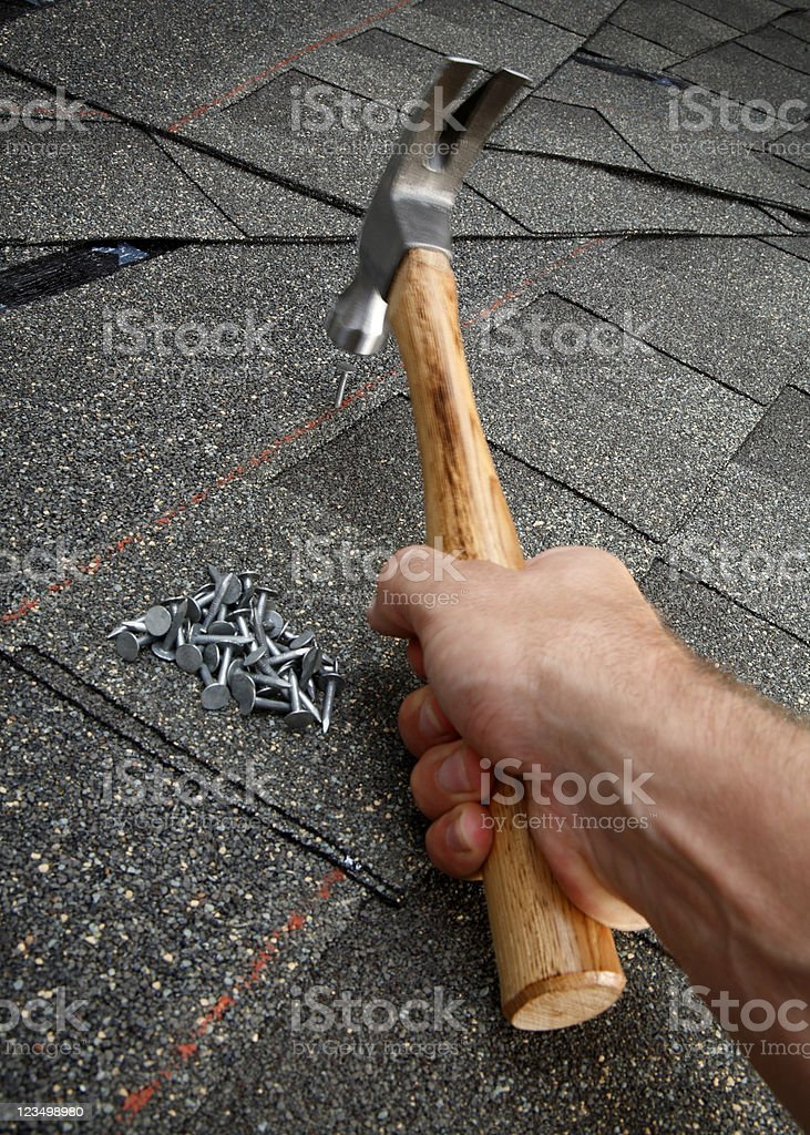 Repairing the Roof on a House royalty-free stock photo