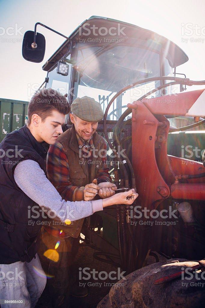 Repairing the Tractor stock photo