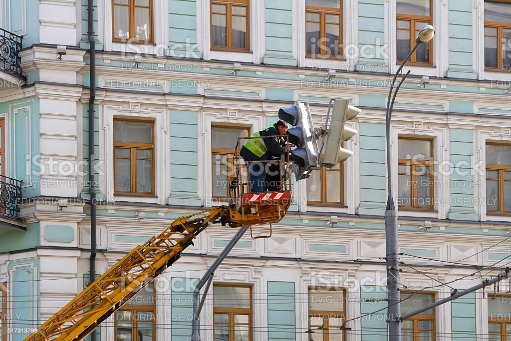 Repairing the traffic light stock photo