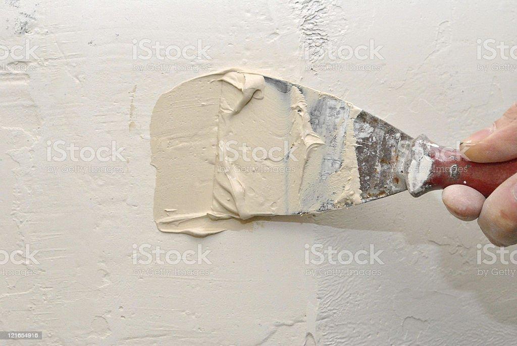 Repairing the wall stock photo
