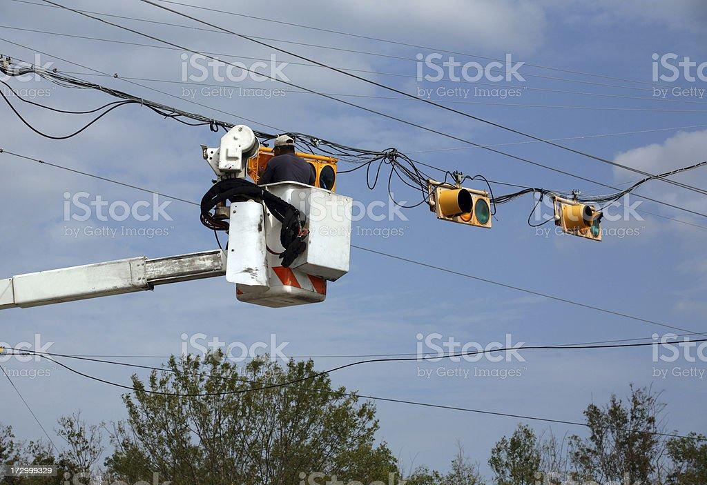 repairing traffic lights after hurricane stock photo