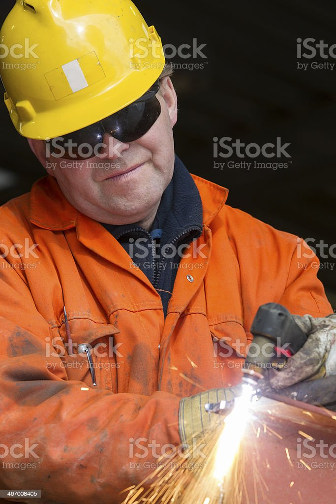 Repairman and mechanic at work with his equipment. stock photo