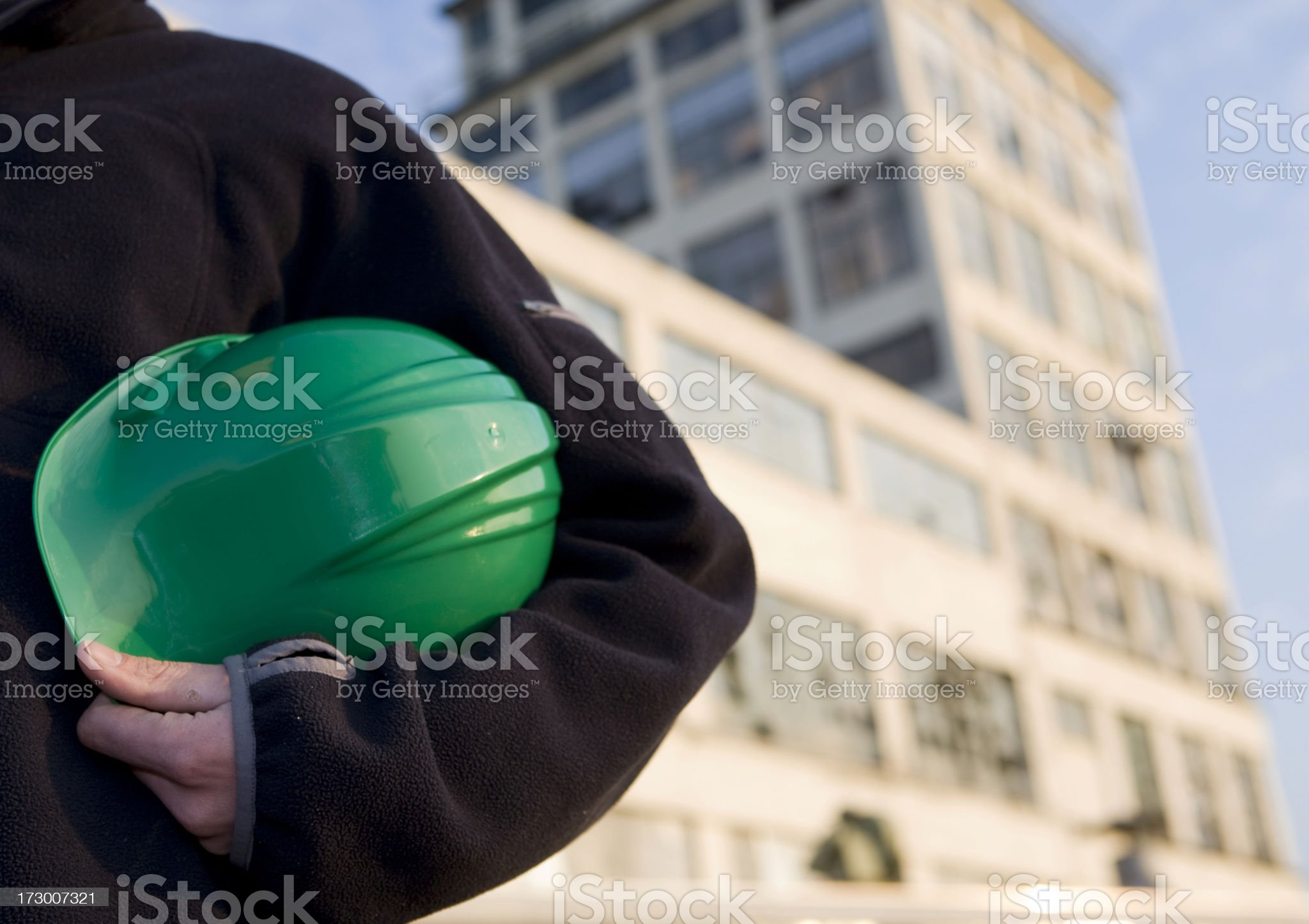 Repairman at work with his helmet. royalty-free stock photo