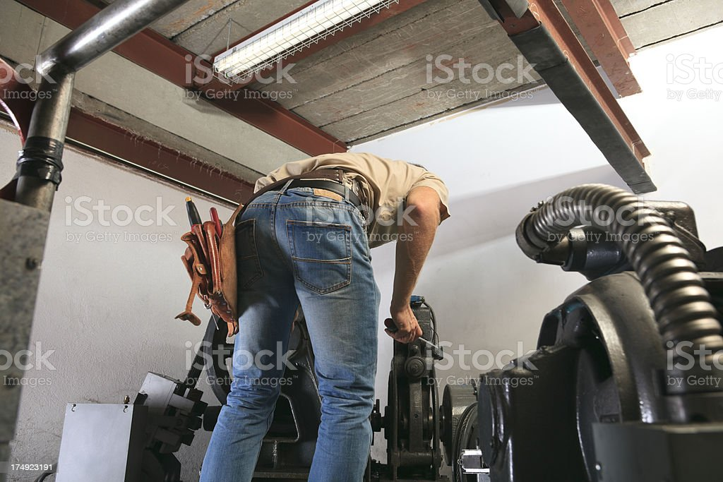 Repairman - Back View Parts Repair stock photo