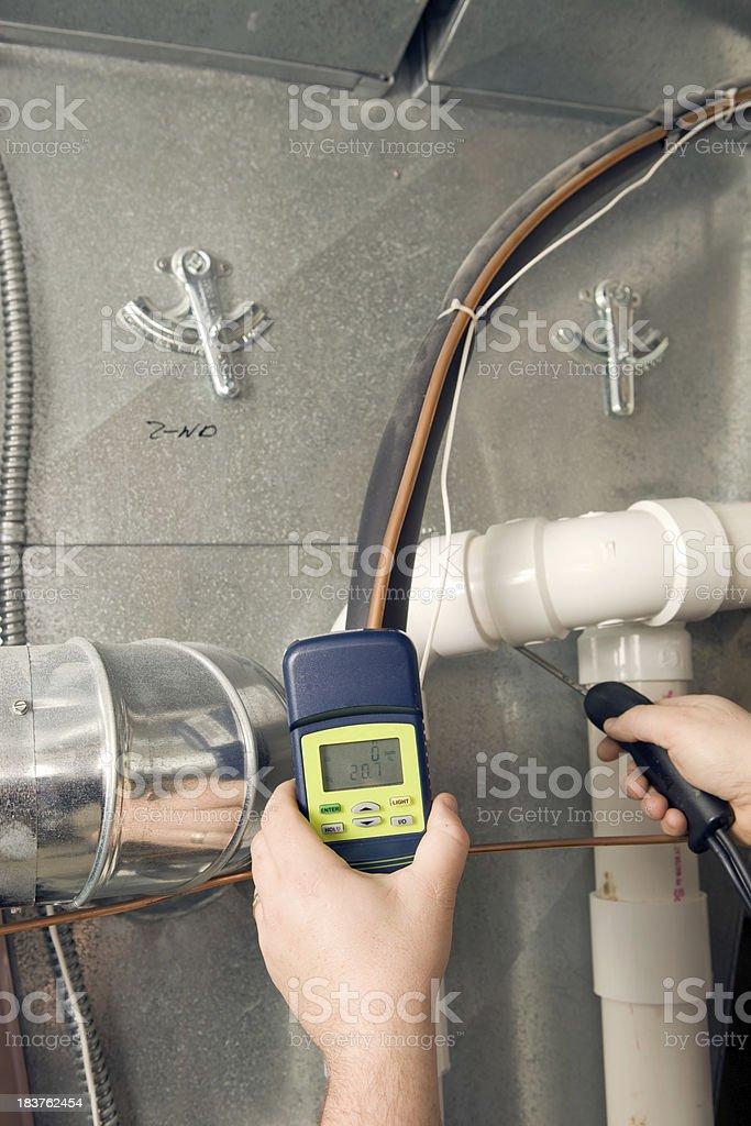 Repairman Checks Carbon Monoxide Level on Furnace Duct stock photo