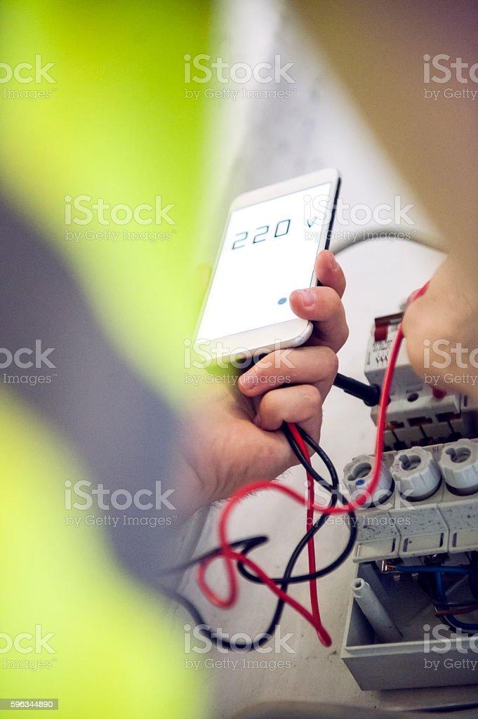 Repairman Checks Voltage stock photo