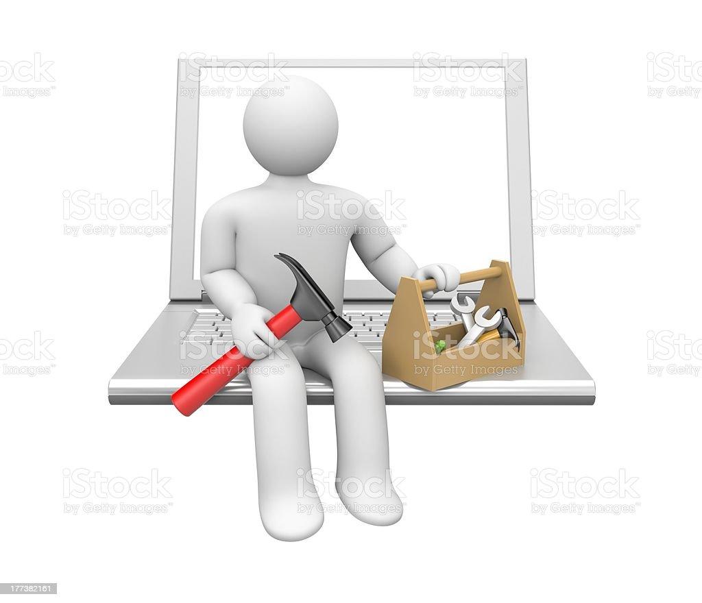Repairman figure sitting on white laptop royalty-free stock photo