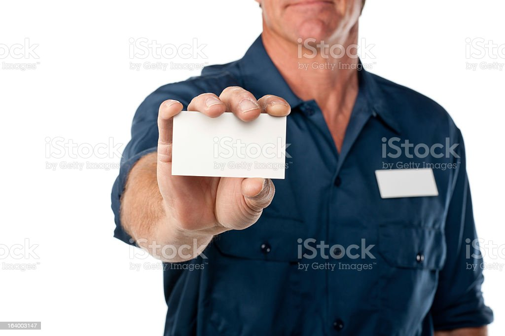 Repairman in blue uniform with blank card royalty-free stock photo