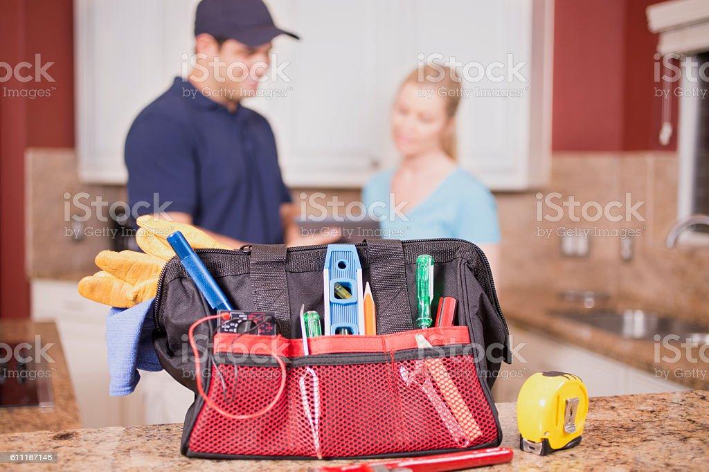 Repairman in customer's home. stock photo