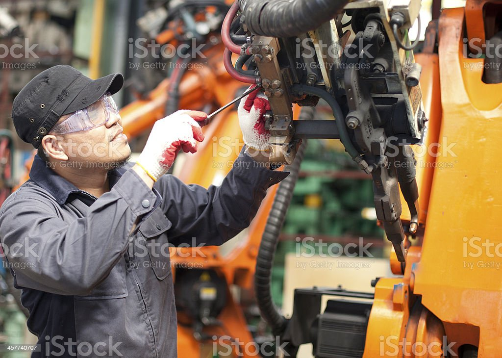 Repairman in factory stock photo