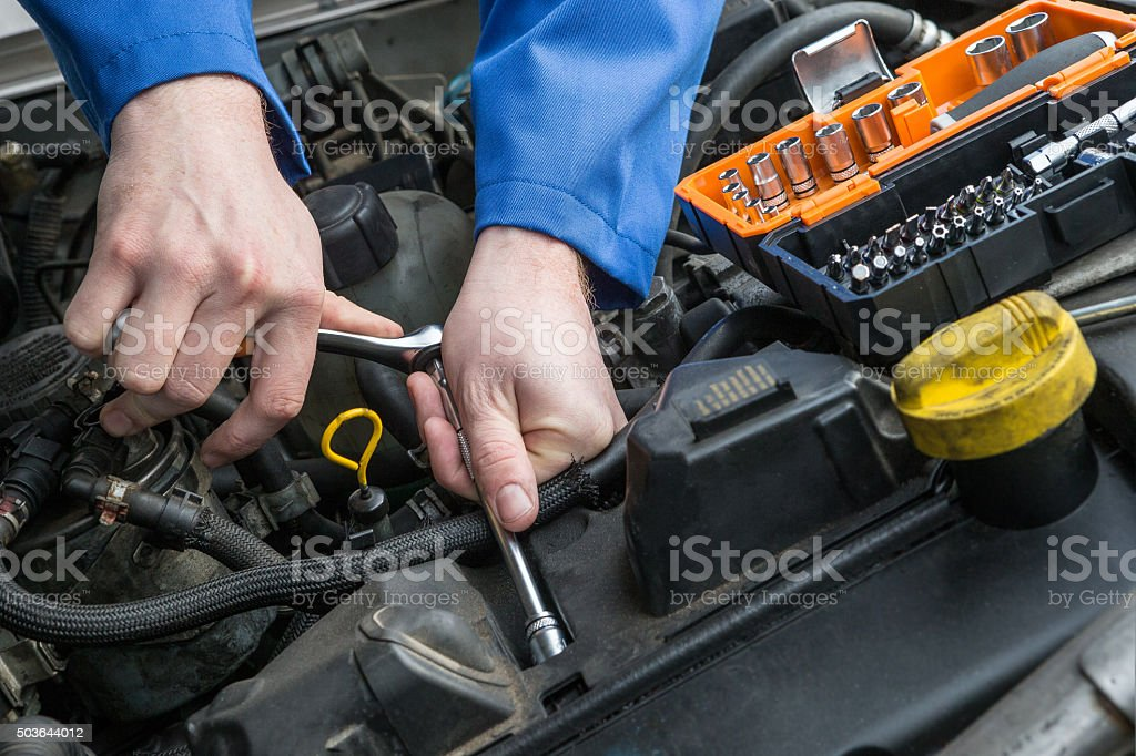 repairman mechanic at car stock photo