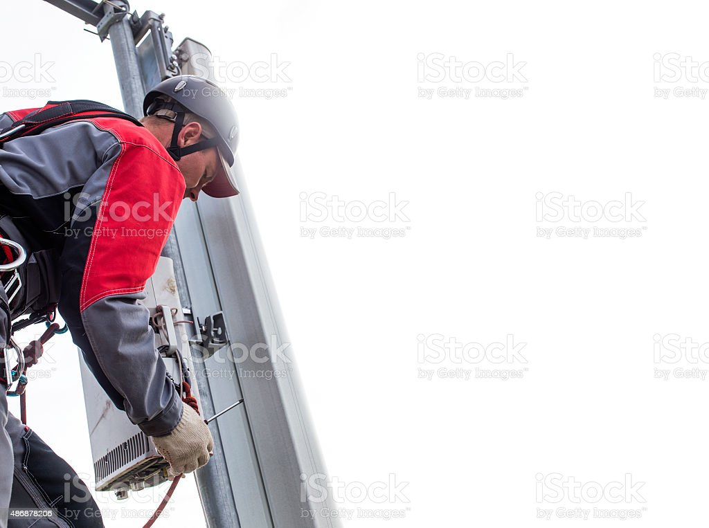 repairman on a telecommunications tower stock photo