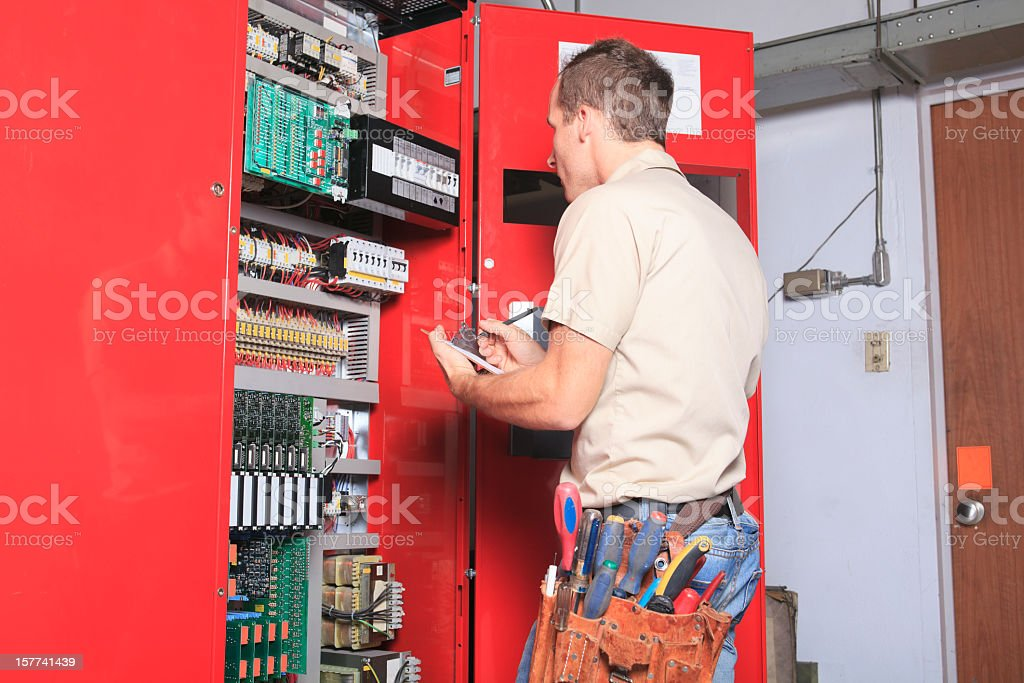 Repairman - Standing Elevator stock photo