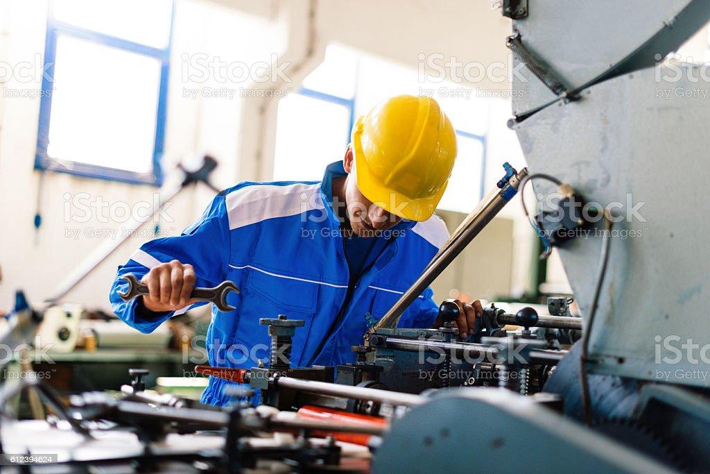 Repairman taking care of broken machinery stock photo