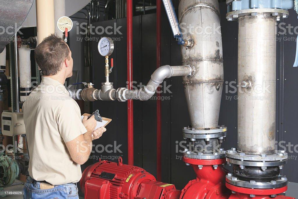 Repairman - Taking Note stock photo