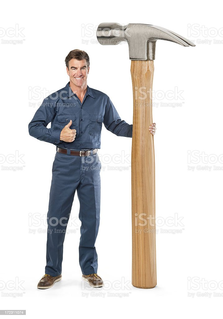 Repairman With Giant hammer royalty-free stock photo