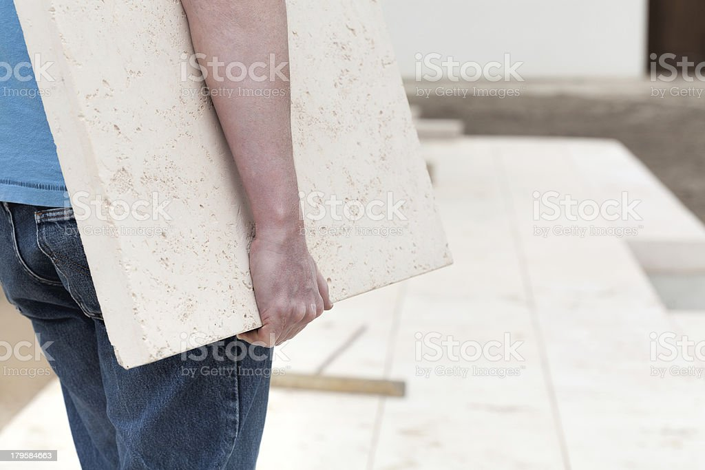 Repairman with slab royalty-free stock photo