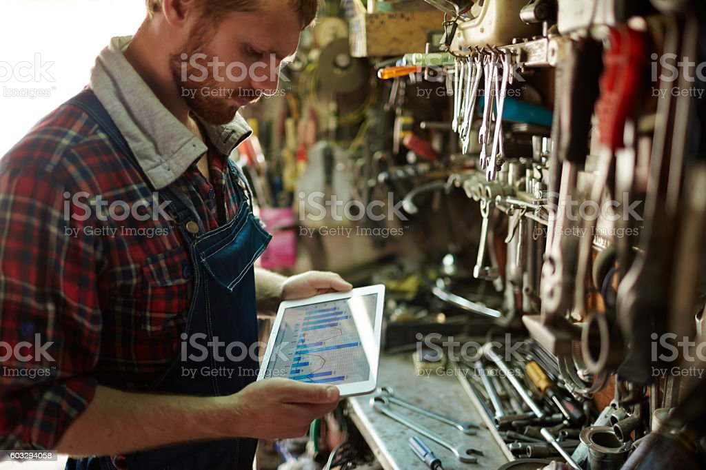 Repairman with touchpad stock photo