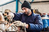 repairman worker repairing a engine excavator