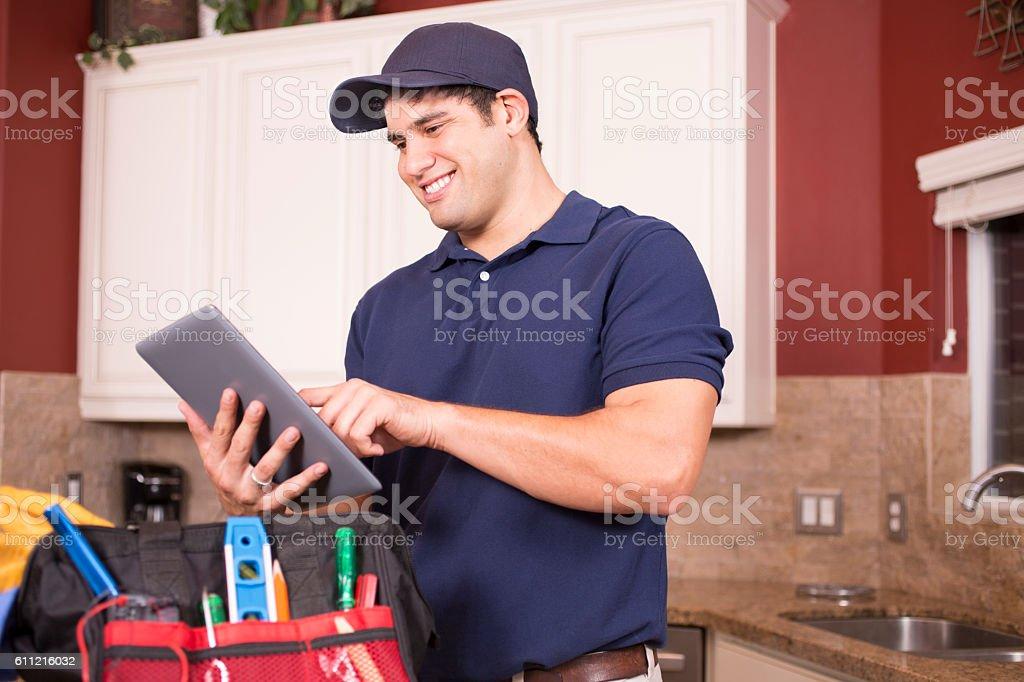 Repairman working inside customer's home. stock photo