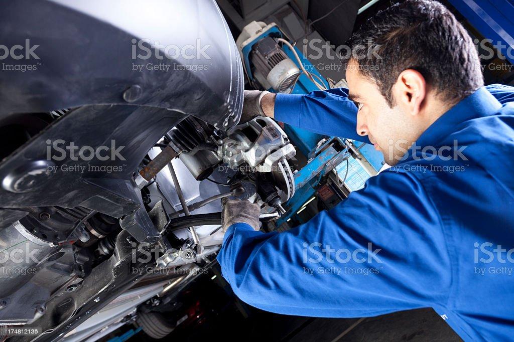 Repairman working on car engine stock photo