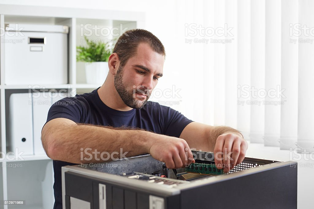 Repairman working with computer stock photo