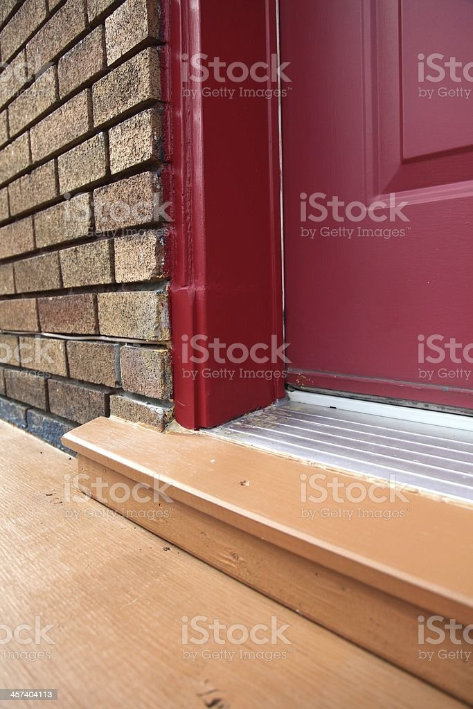 Reparation of a damaged, rotting door (after works) royalty-free stock photo