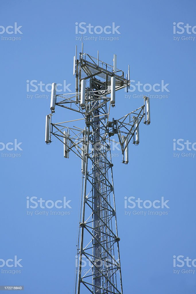 Repeater tower against a blue sky. Telecommunications. stock photo