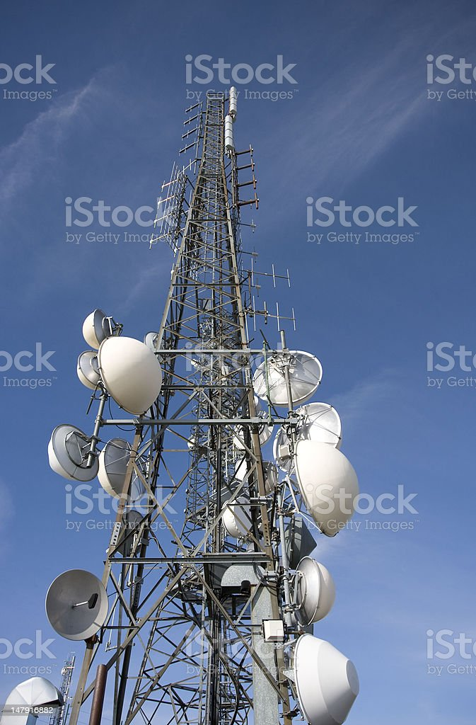 Repeaters Radio Tv on blue sky stock photo
