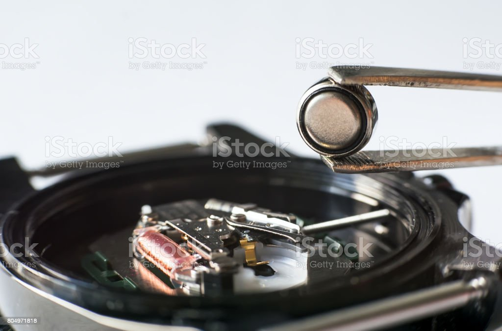 Replace the battery in a wristwatch stock photo