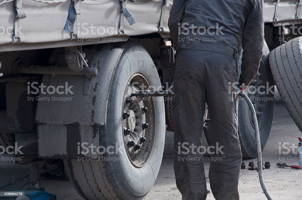Replacement and repair of wheels stock photo