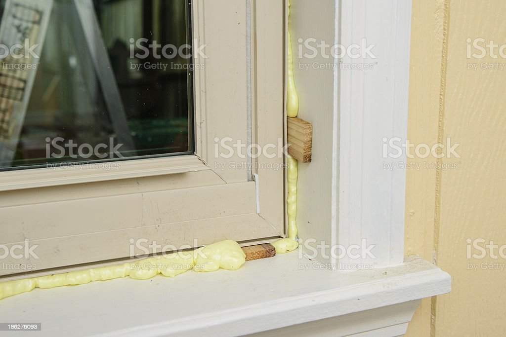 Replacement window with foam insulation. stock photo