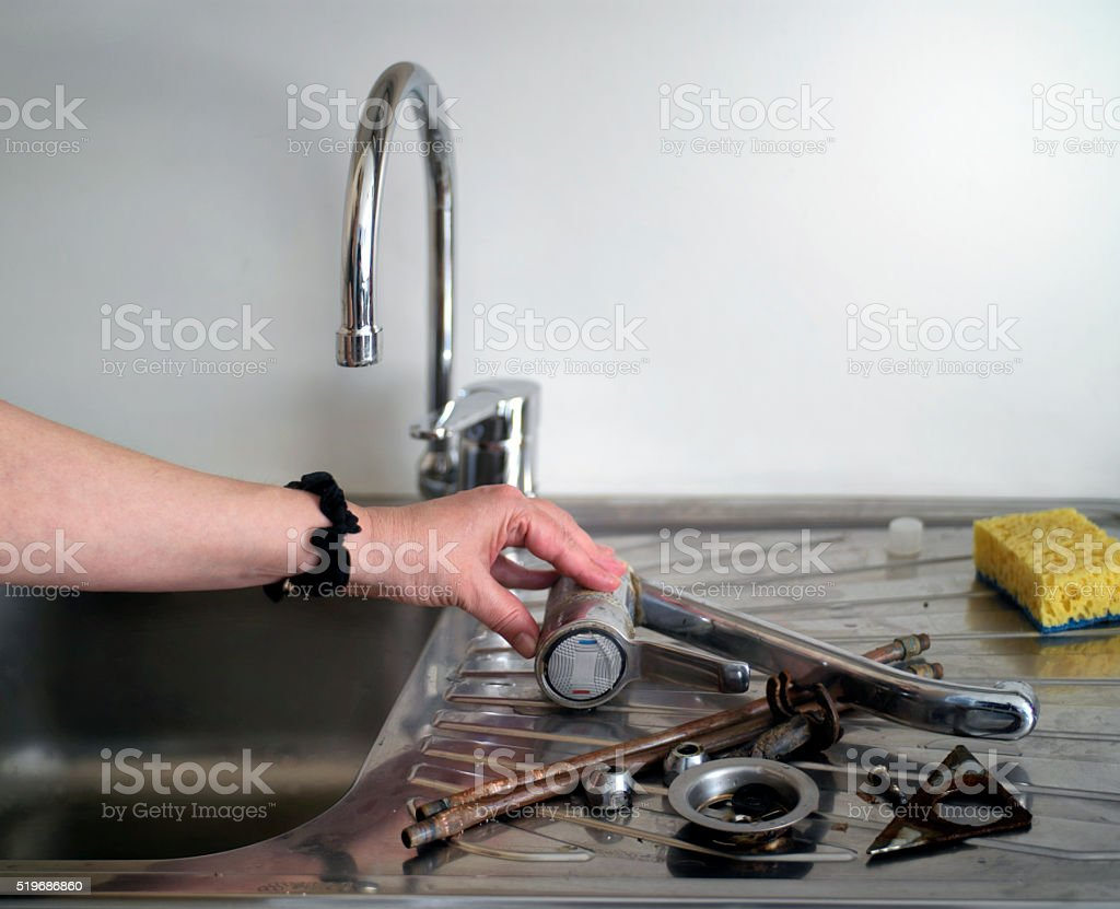 Replacing A Kitchen Tap stock photo