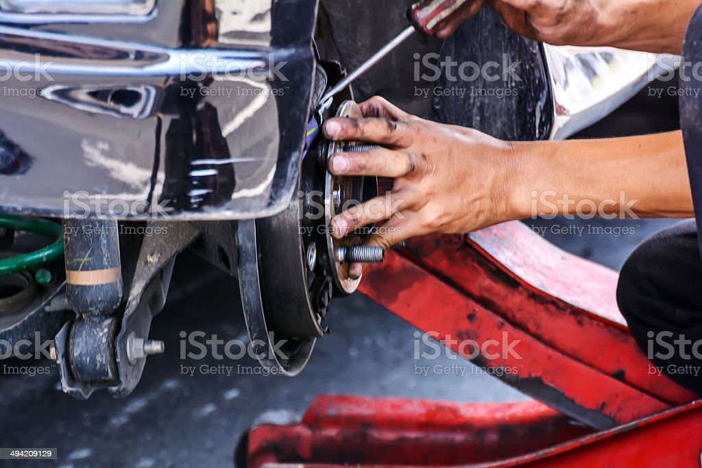 Replacing brakes vehicle stock photo