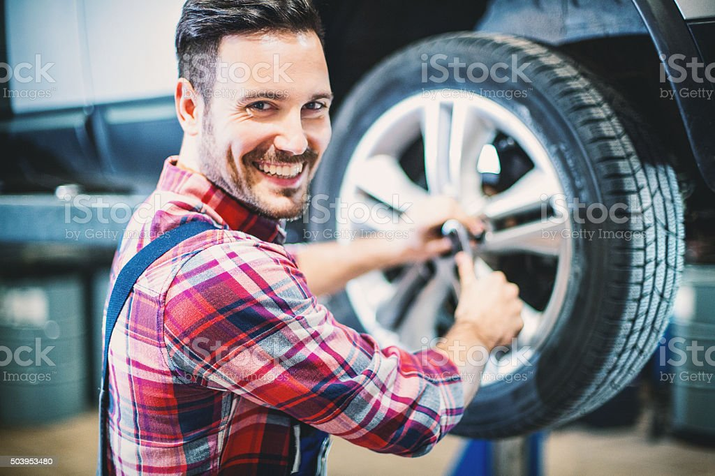 Replacing car wheel and tyre. stock photo