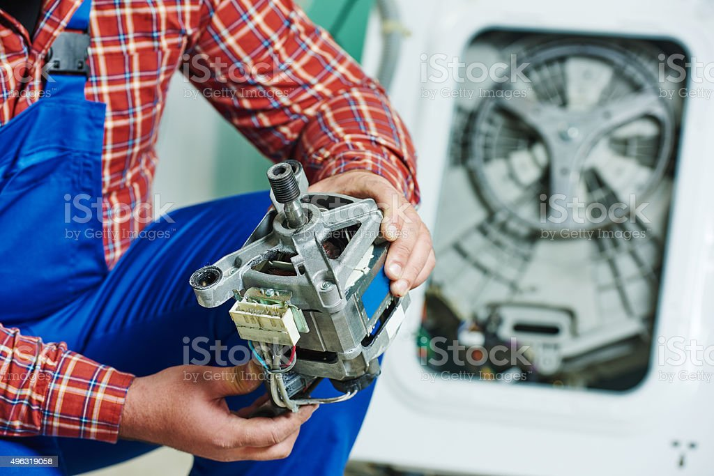 replacing engine of washing machine stock photo