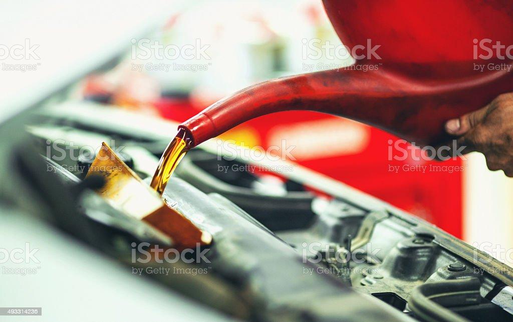 Replacing engine oil. stock photo