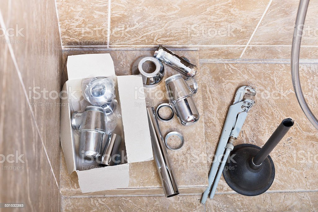 replacing of corroded sink trap stock photo