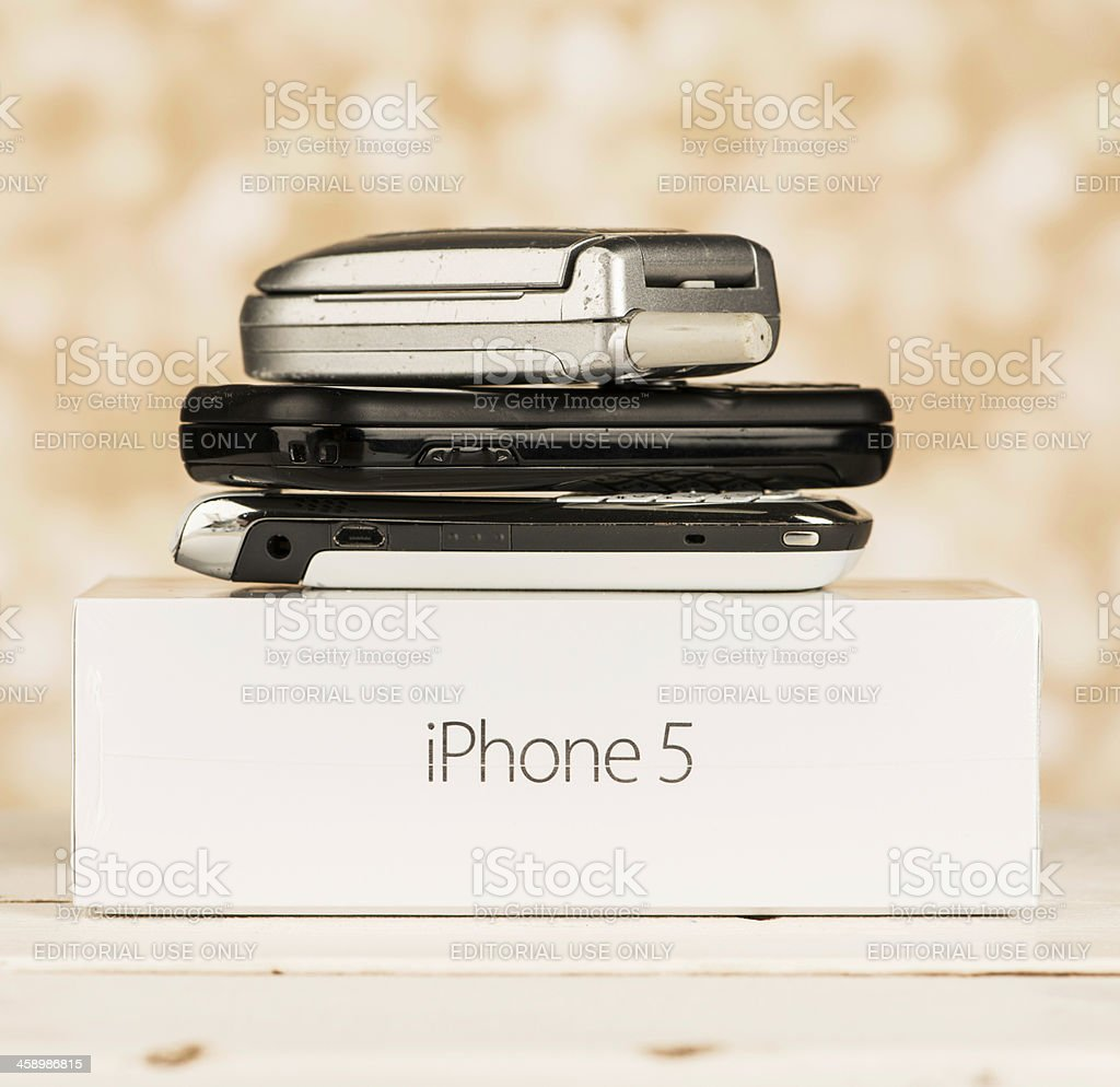 Replacing Old Phones with a New iPhone 5 stock photo