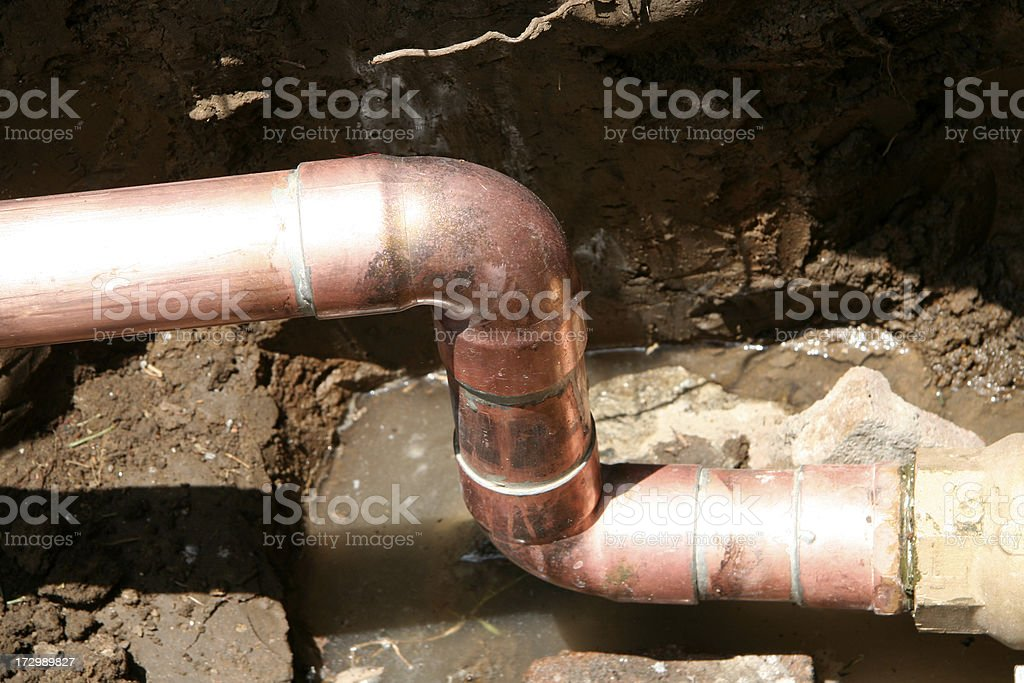 Replacing the water line royalty-free stock photo
