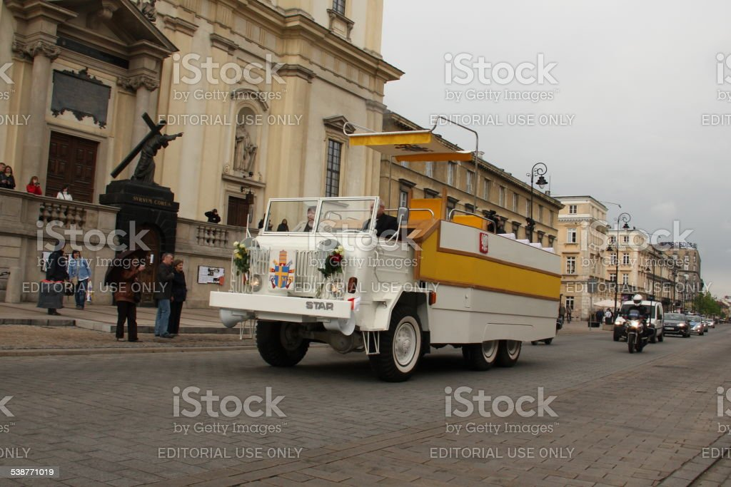 Replica of Popemobile truck on the parade stock photo