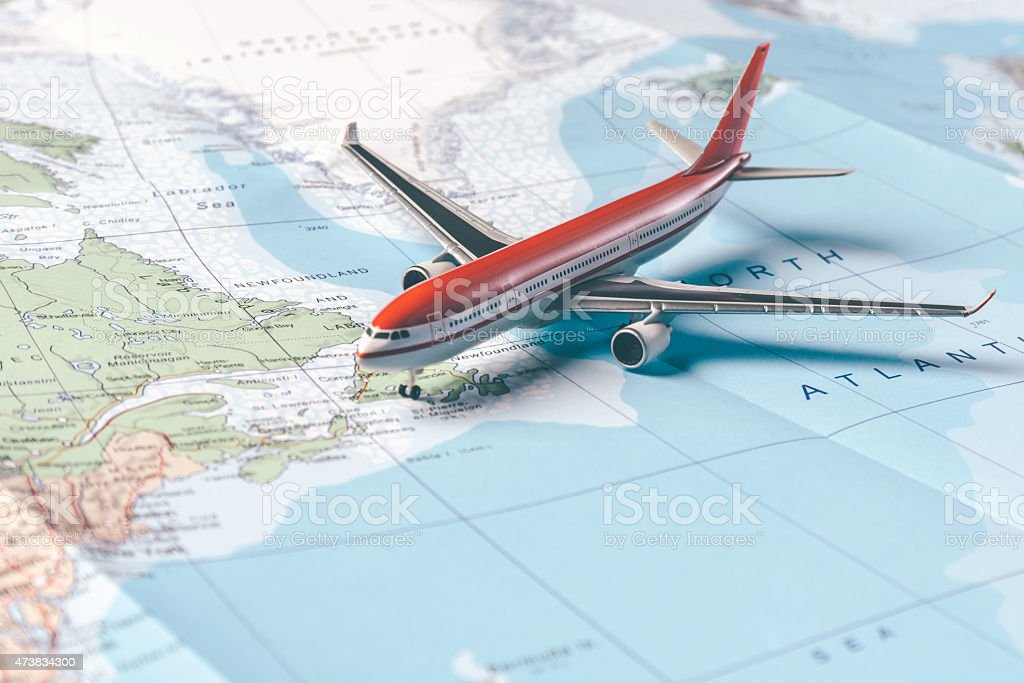 A replica plane over a map, looking ready to fly stock photo